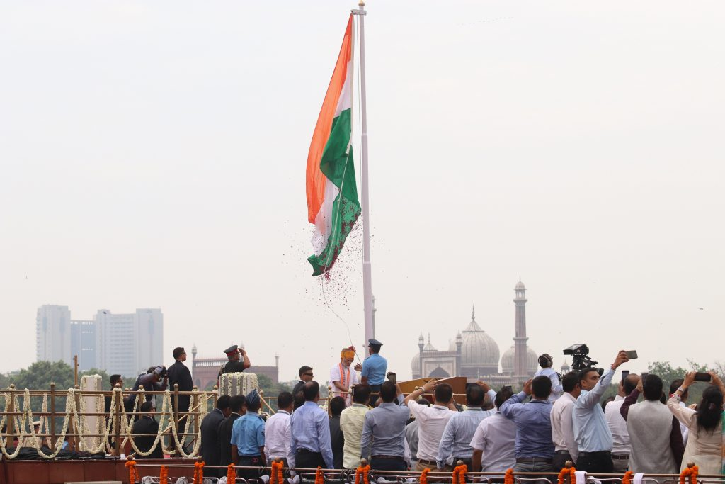 Prime Minister Narendra Modi raises the tri-colour flag at the Red Fort on Independence Day